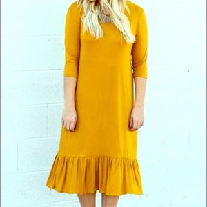 Dresses & Skirts - Mustard ruffle dress😍